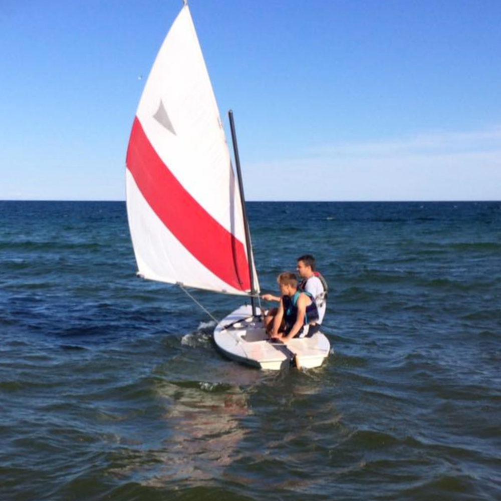 Cuyler skippering a Sunfish prior to his college sailing career
