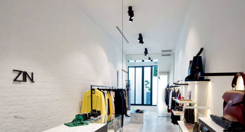 ZIN Hasselt, high fashion store designed by LOFT22 architecture and styled with art from LOFT22 art space, featured in the newest catalogue of Modular Lighting Instruments.