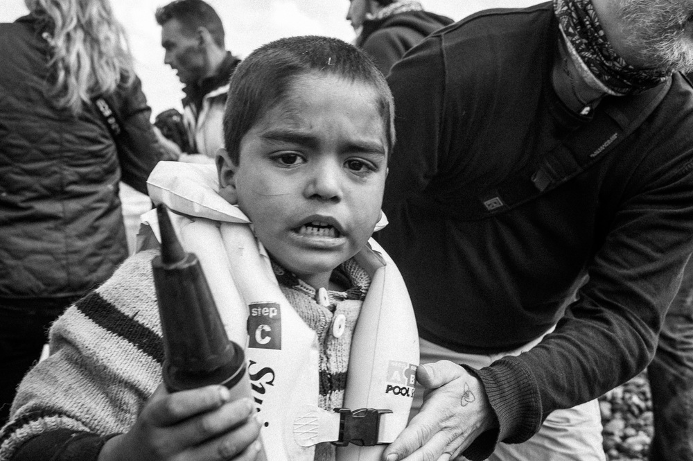 A Kurdish boy from the Syrian city of Afrin receives help after arriving on the Greek island of Lesbos along with other migrants and refugees.