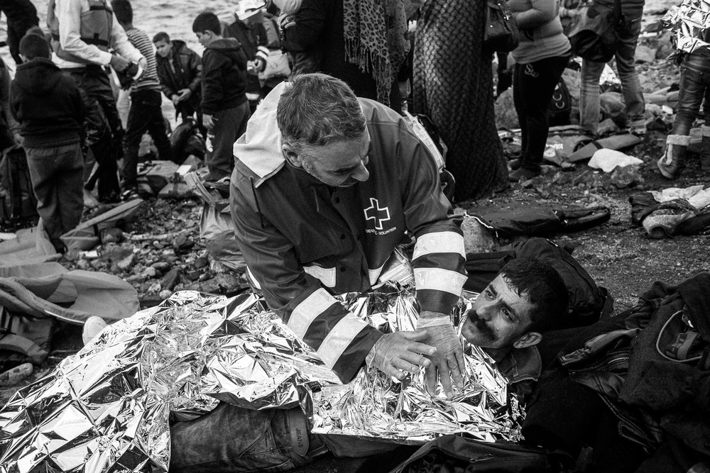 An injured refugees is helped by medics after making the crossing from Turkey to the Greek island of Lesbos.