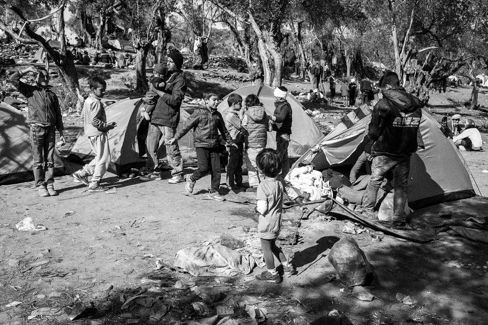 Migrants wait in a camp by the Moria processing centre on the island of Lesbos.
