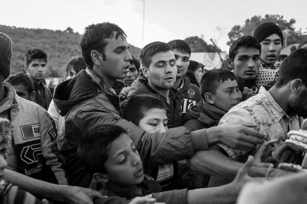Refugees and migrants fighting for food in a Moria camp on the Greek Island of Lesbos.