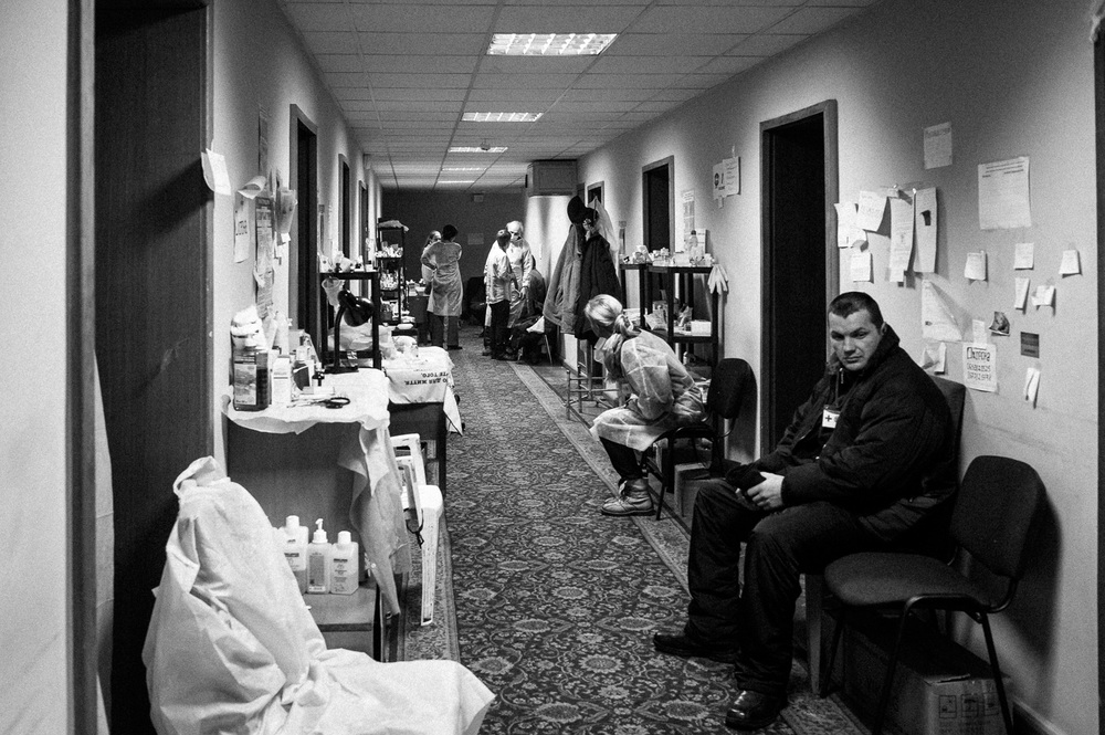 Volunteers work inside a medical centre where anti-government protesters receive medical treatment in Kiev, Ukraine.