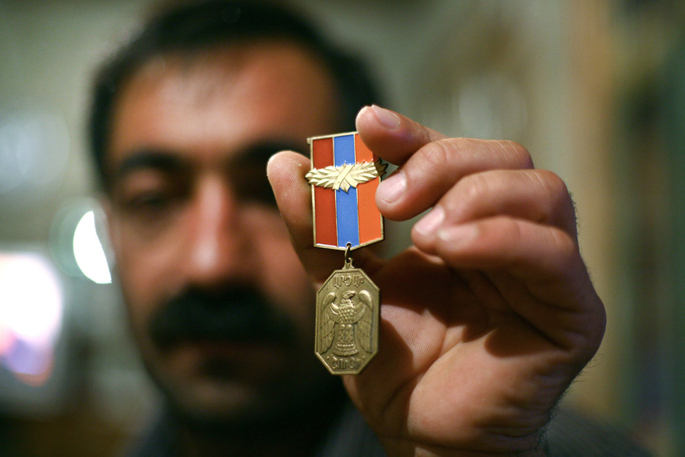 Garnik is a veteran of the war in Nagorno-Karabakh, works now as a security agent at the Shushi Revival Fund Organisation headquarters.