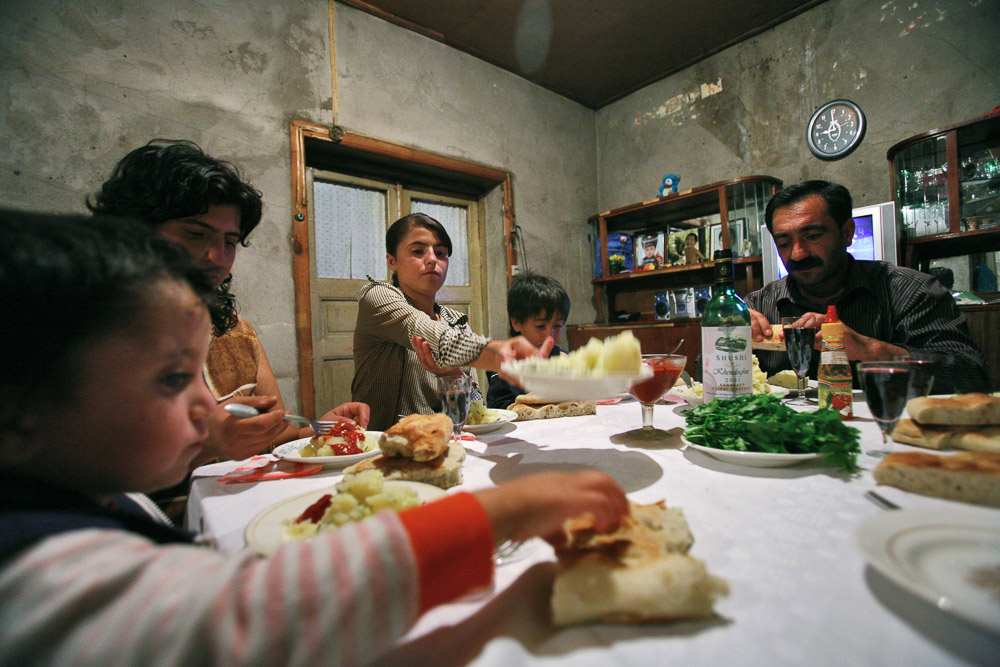 Garnik Arustamyan and his family are having dinner in their house in Shushi.