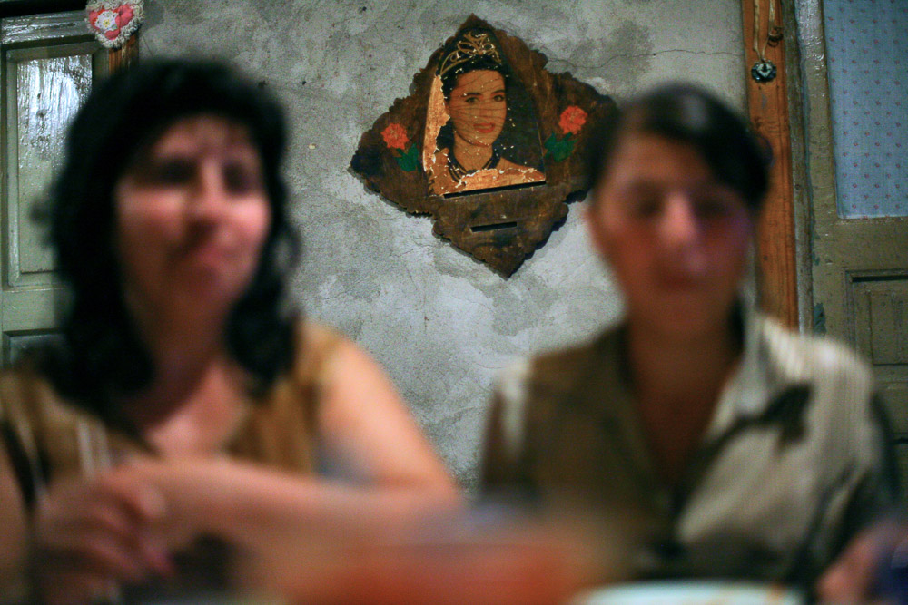 Picture with a woman wearing an Armenian national costume is hung on the wall in Garnik Arustamyan's house in Shushi.