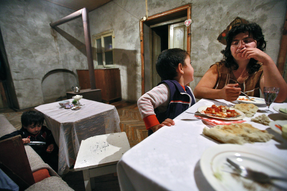 Hasmik Arustamyan (age 35), Garnik's wife and her youngest son Arnold (age 4) are having dinner in their house in Shushi.
