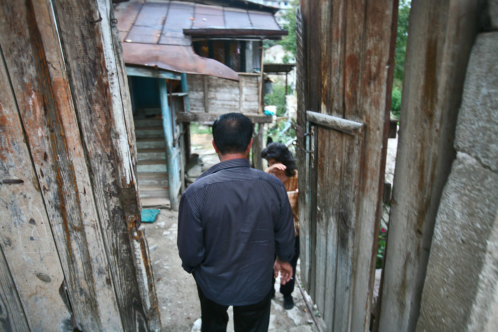 Garnik Arustamyan returns home in the morning after the night shift at his workplace, Shushi Revival Fund Organisation in Shushi.