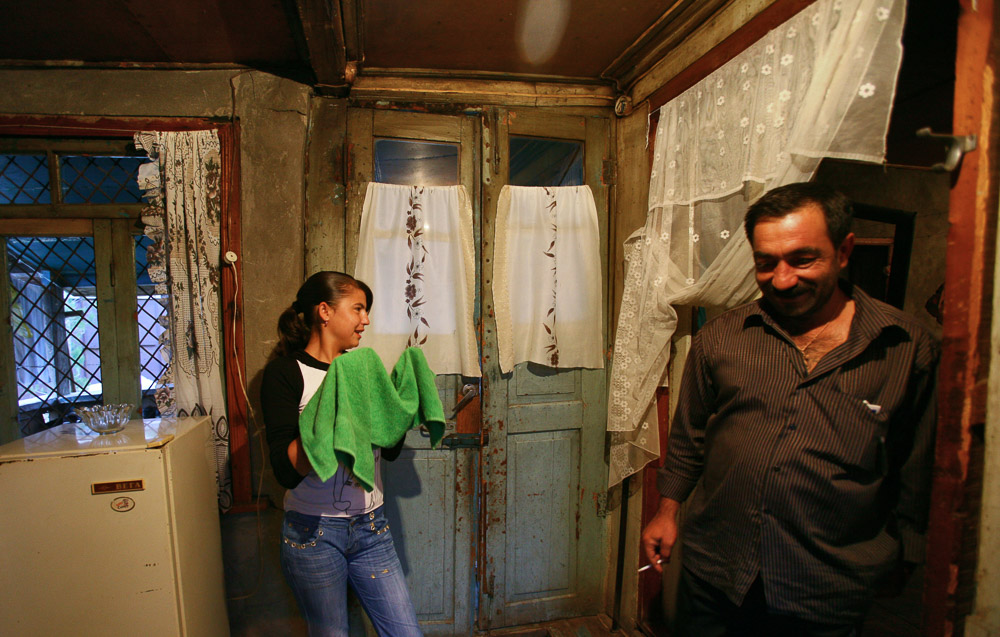 Alisa Arustamyan (age 15), the elder daughter of Garnik Arustamyan wipes her face with a towel in her family house in Shushi.