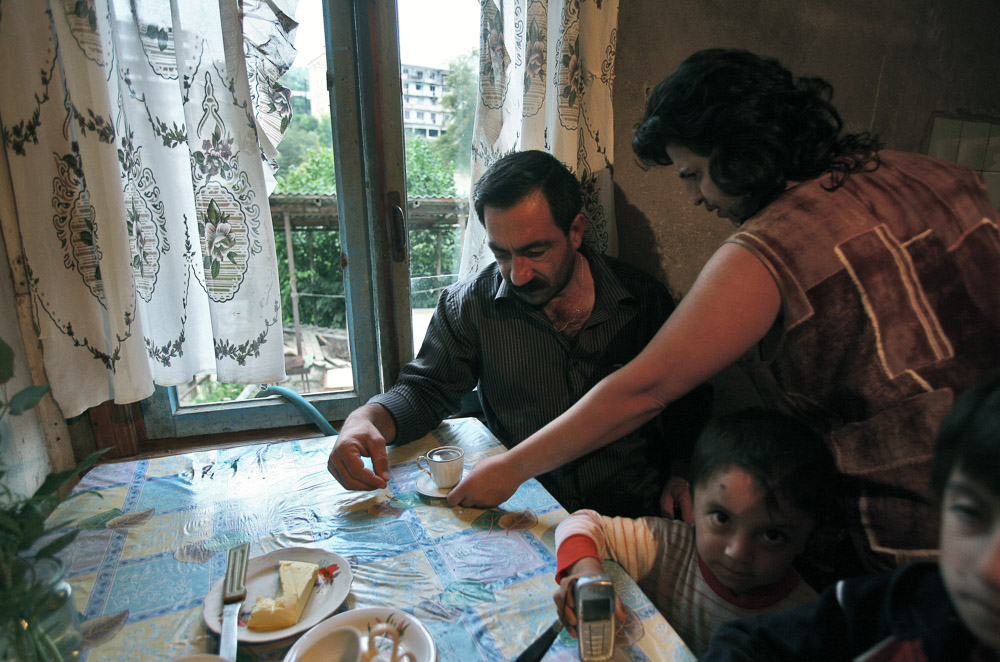 Hasmik Arustamyan (age 35) brings coffee to her husband at their house in Shushi.