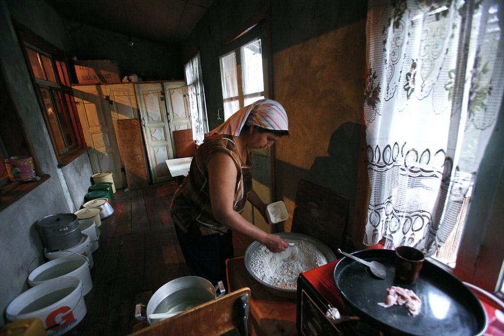 Hasmik Arustamyan (age 35), Garnik's wife, makes bread in her house in Shushi.