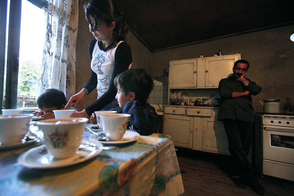 Garnik Arustamyan looks at his children having breakfast in their house in Shushi.