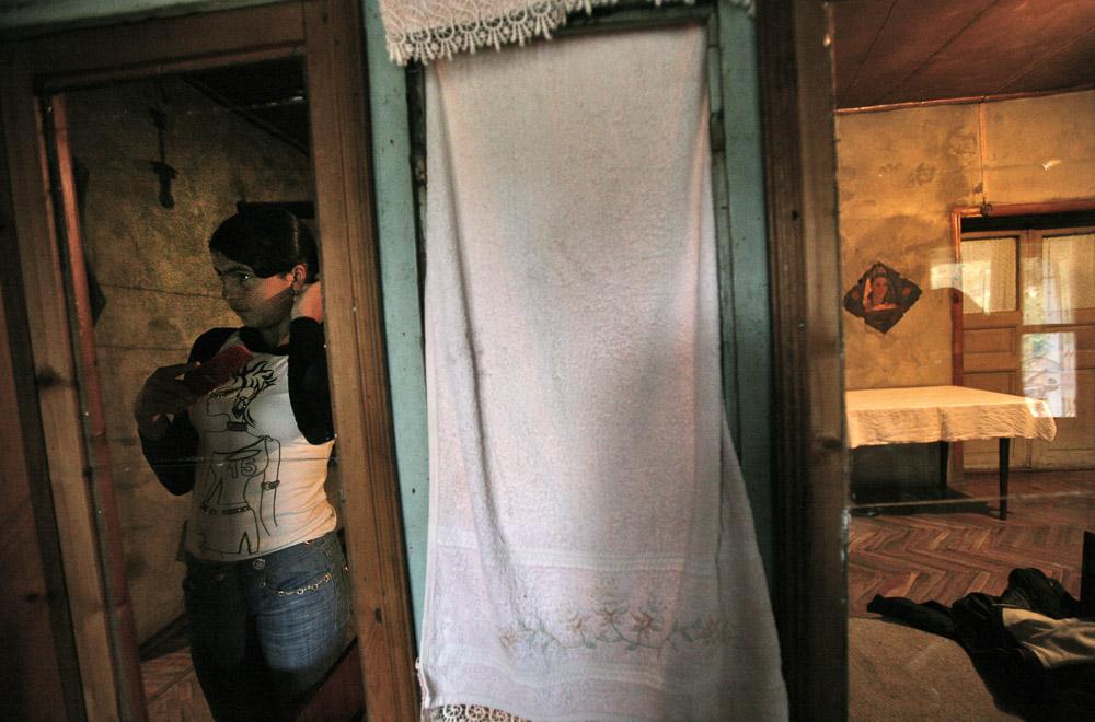 Alisa Arustamyan (age 15), the elder daughter of Garnik Arustamyan, brushes her hair in the family house in Shushi.