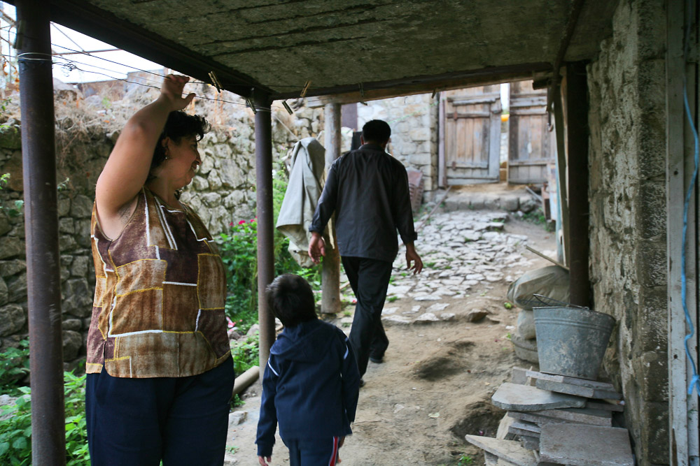 Garnik Arustamyan walks in the yard of his house in Shushi accompanied by his wife Hasmik (age 35) and her daughter Haikuhi (age 6).
