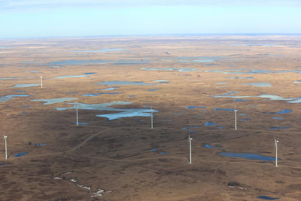 The Tatanka Wind Farm, amidst prairie wetlands on the border between North and South Dakota. (Krista Lundgren/US Fish and Wildlife Service)