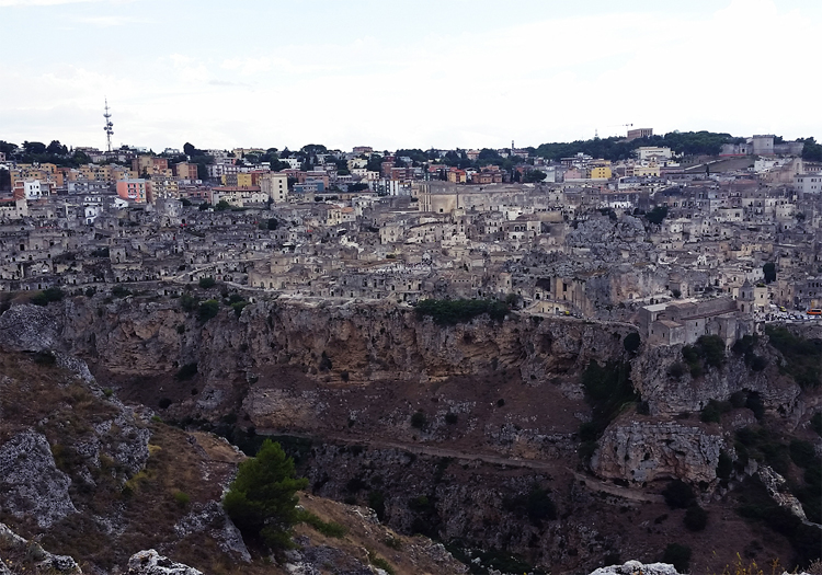 Image 3: The layers of Matera, thousands of years in use, as seen from across the Gravina. September, 2015. Photograph by Jessie Wilcox