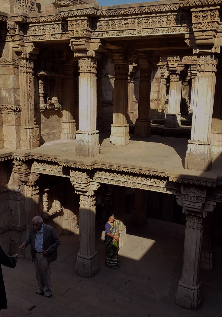 Image 7:  A visiting woman stands in the shadow of the now protected Adalaj-ni-vav. While mainly touristic, other wells are being used as temples or have temples associated with them. December, 2015. Photograph by Jessie Wilcox