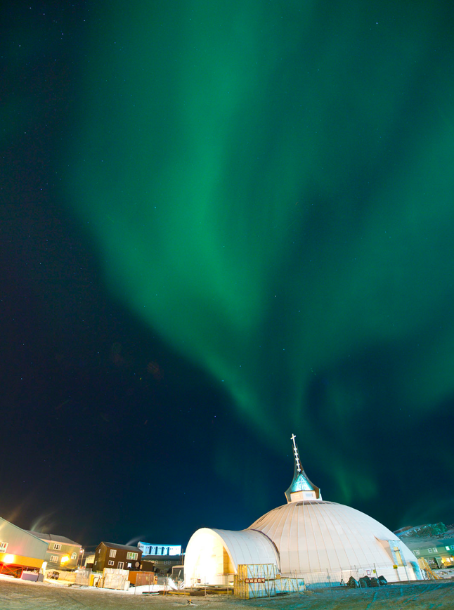 St.Jude's Cathedral, Iqualuit, Nunavut, with the northern lights. Harriet Burdett-Moulton for Santec Architects, 2011. Photo courtesy of NCC Development Ltd.