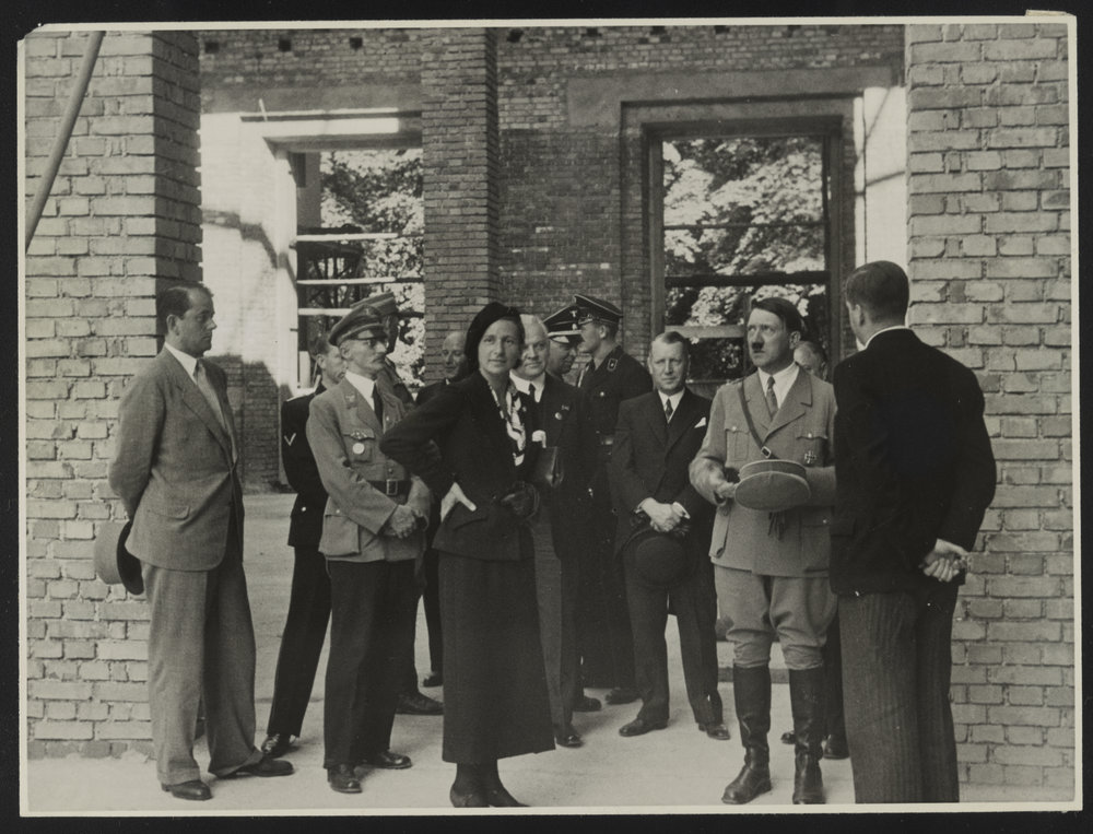 Architect Albert Speer (far left), interior designer Gerdy Troost, Hitler, and others inspecting the Haus der Kunst construction site in Munich on June 29, 1935, on the occasion of the topping-out ceremony. Photograph by Heinrich Hoffman, Library of Congress