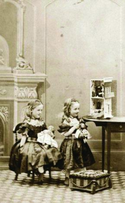 Image 3 / Victorian girls playing with their dolls and dollhouse, 1862. Getty Images