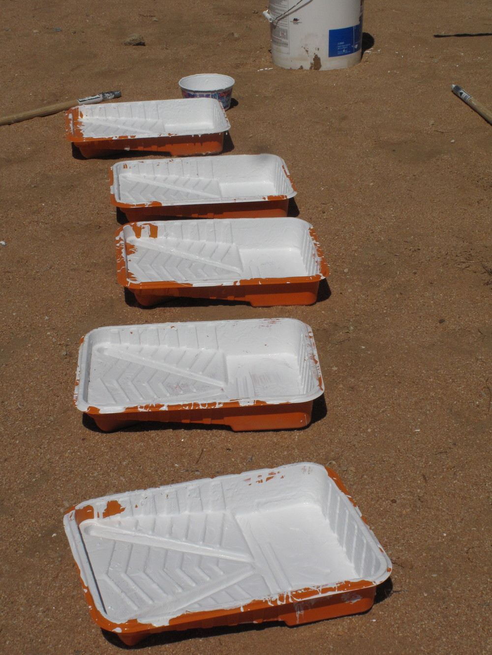 Paint trays used by volunteers during one of the maintenance days at the Noah Purifoy Outdoor Desert Art Museum.