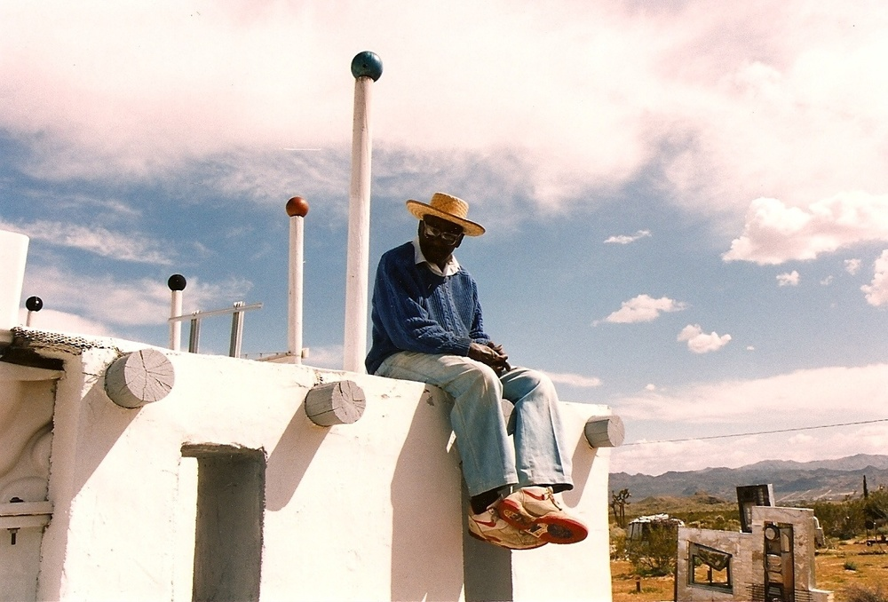 Noah sitting on The White House in construction, Joshua Tree, early 1990s