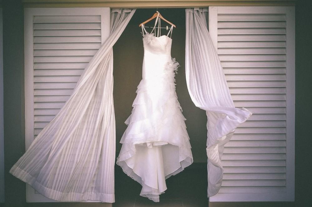 san   diego wedding photographer | white wedding dress hanging by wooden coat   hanger