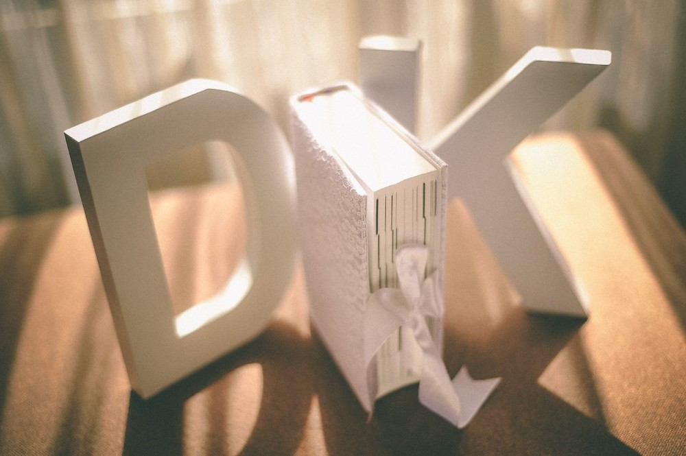 san   diego wedding photographer | white book between the letters K and D