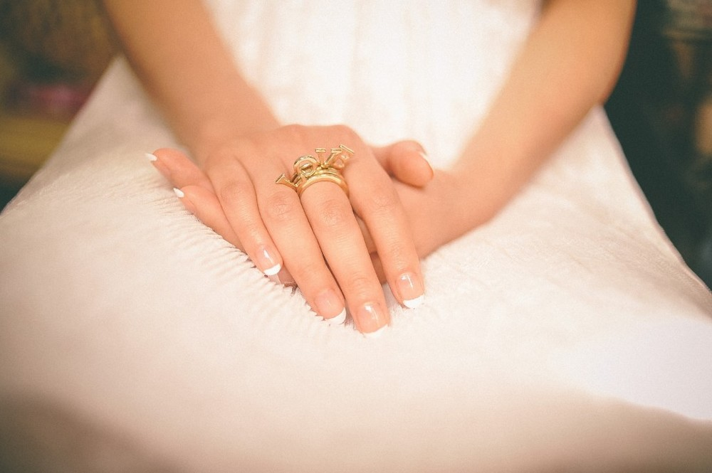 san   diego wedding photographer | woman's hands on her lap with ring that says   love on it