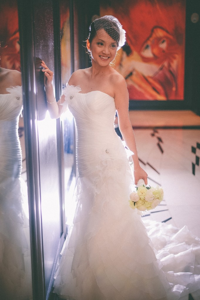 san   diego wedding photographer | bride to be posing with painting in background