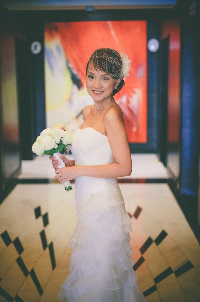 san   diego wedding photographer | woman posing in the middle of hallway with   painting behind