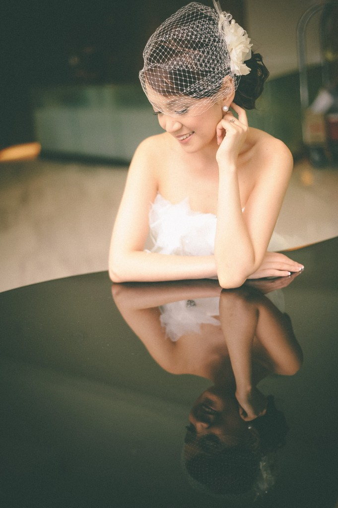 san   diego wedding photographer | bride to be leaning on reflective surface