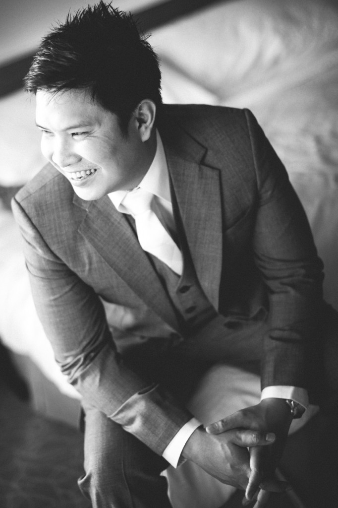 san   diego wedding photographer | monotone shot of groom to be sitting down   smiling