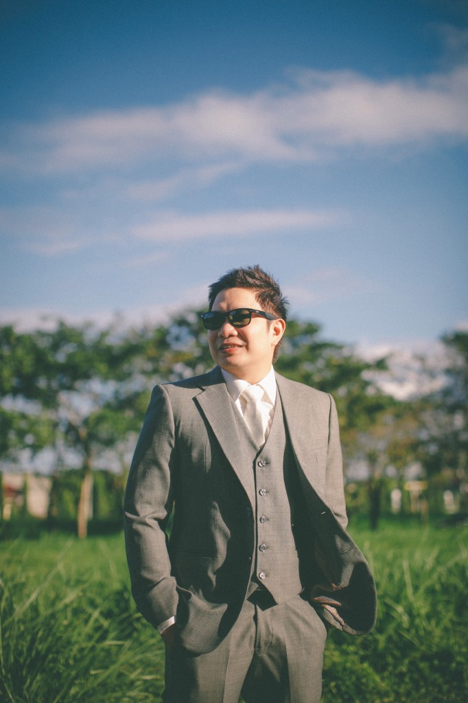 san   diego wedding photographer | groom to be standing in middle of field