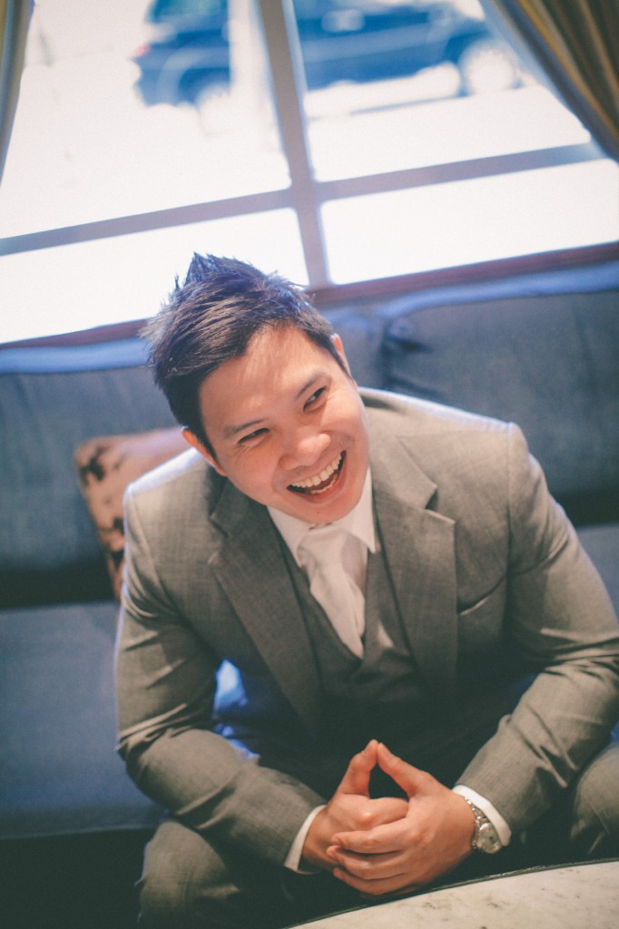 san   diego wedding photographer | groom to be in grey suit sitting smiling