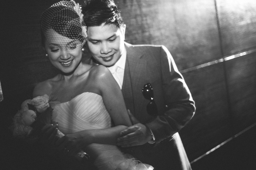 san   diego wedding photographer | monotone shot of groom with shades in front   pocket holding bride from behind