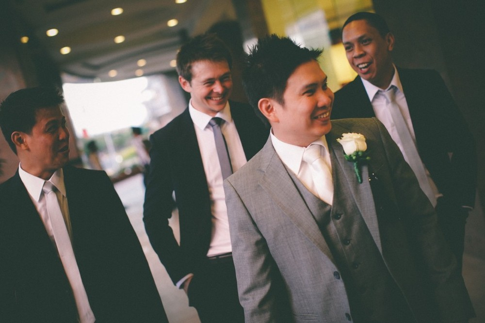 san   diego wedding photographer | groom in grey with groomsmen behind him walking