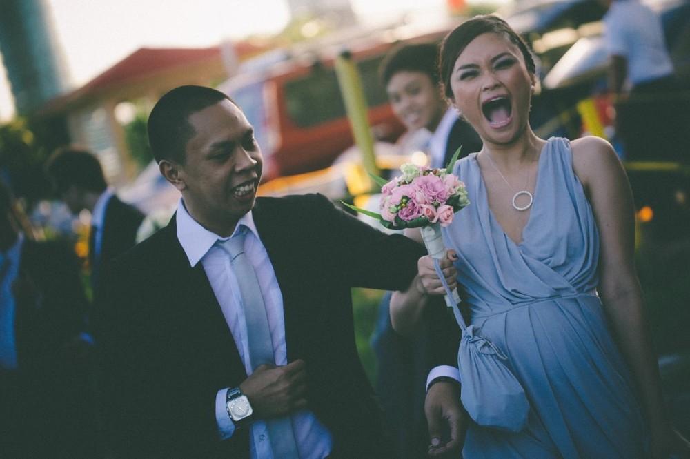 san   diego wedding photographer | woman in light blue dress shocked with man's arm   around her arm