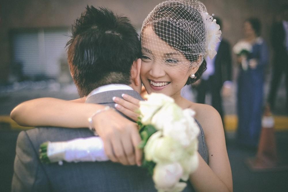san   diego wedding photographer | woman in white dress and mesh veil hugging   groom