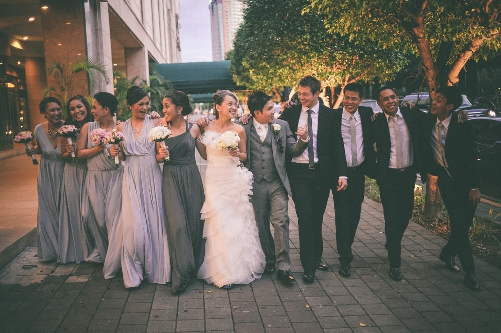 san   diego wedding photographer | shot of bride and groom with bridesmaids and   groomsmen lined up walking laughing