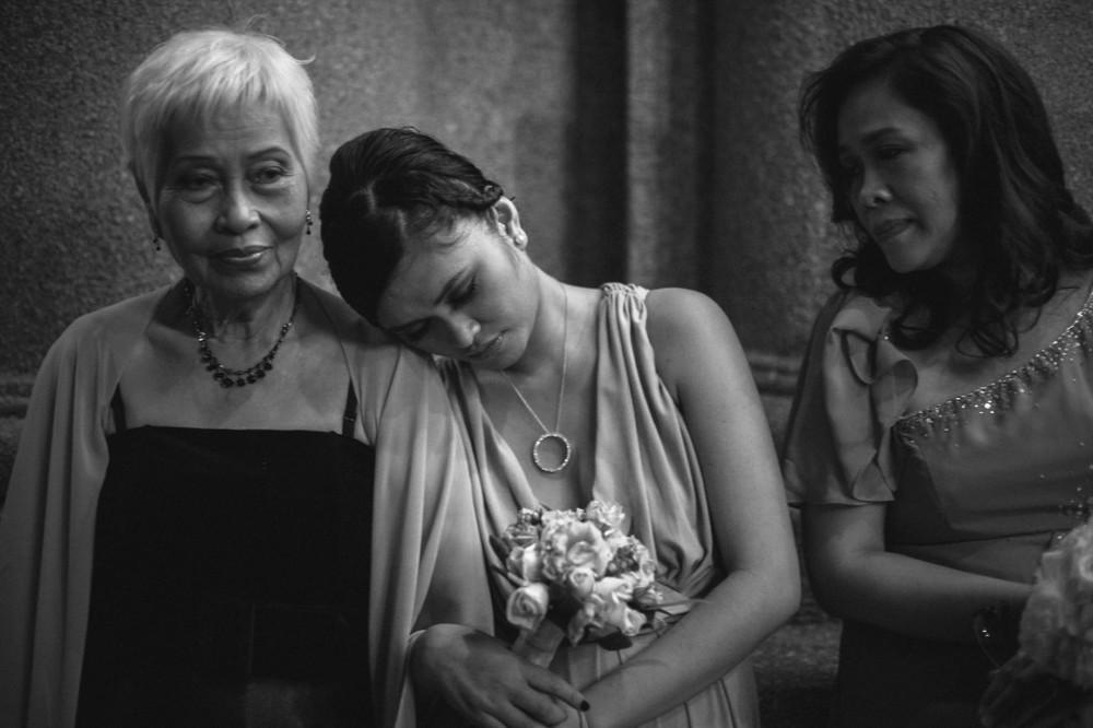 san   diego wedding photographer | monotone shot of woman sleeping on older woman's   shoulder