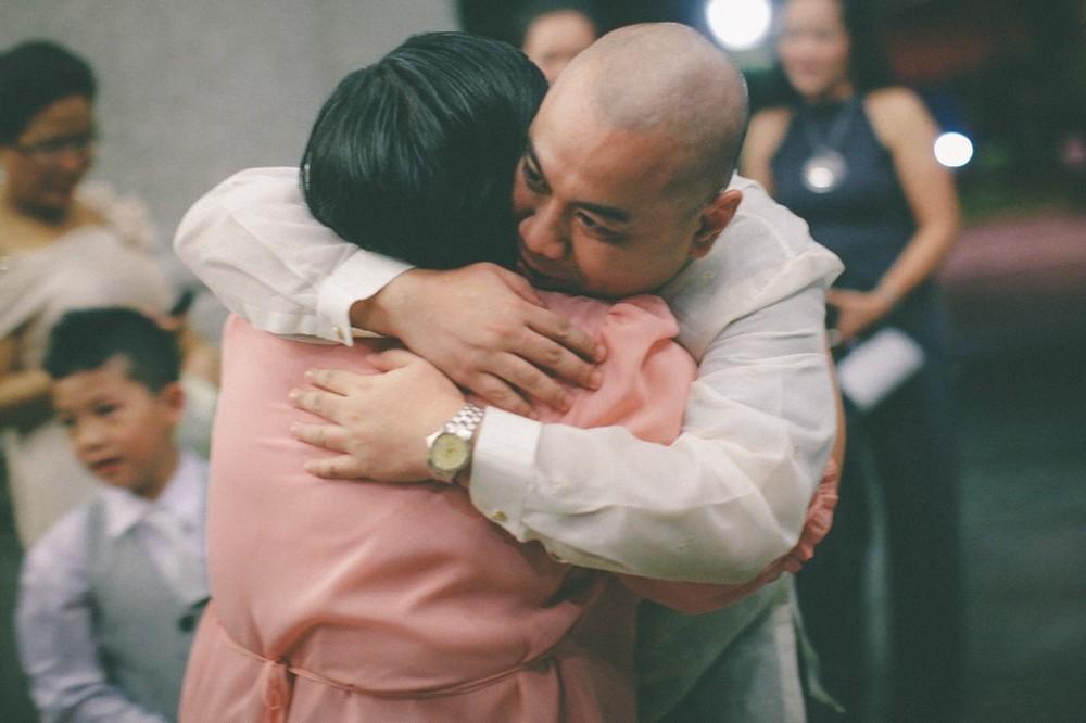 san   diego wedding photographer | bald man hugging woman in peach dress