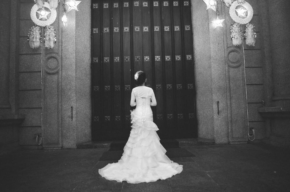 san   diego wedding photographer | bride standing in front of big chapel door