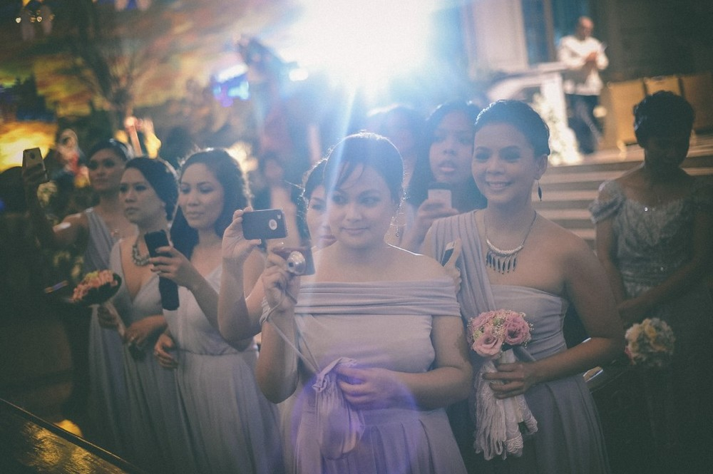san   diego wedding photographer | bridesmaids in dresses taking pictures with   their phones