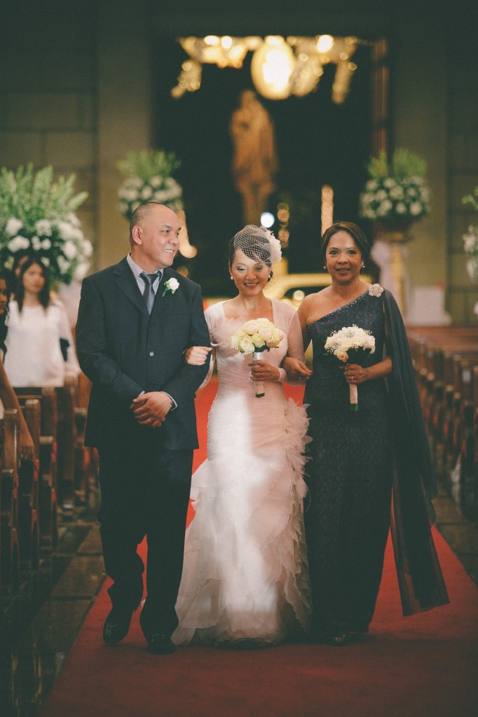 san   diego wedding photographer | bride being walked down the aisle by her parents   in dark outfits