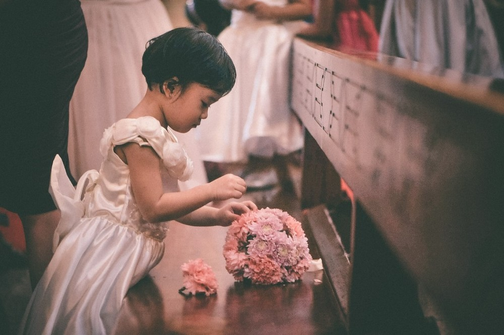 san   diego wedding photographer | little girl in dress playing with bouquet