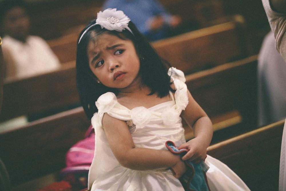san   diego wedding photographer | child in dress looking perplexed