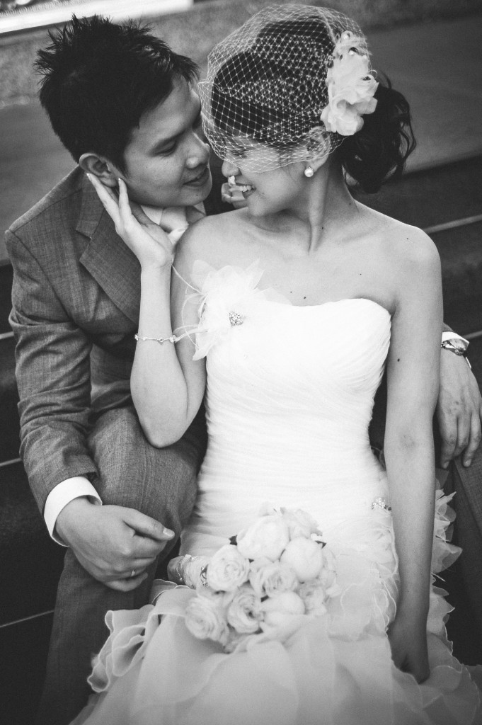 san   diego wedding photographer | monotone shot of bride and groom as groom sits   on stairs