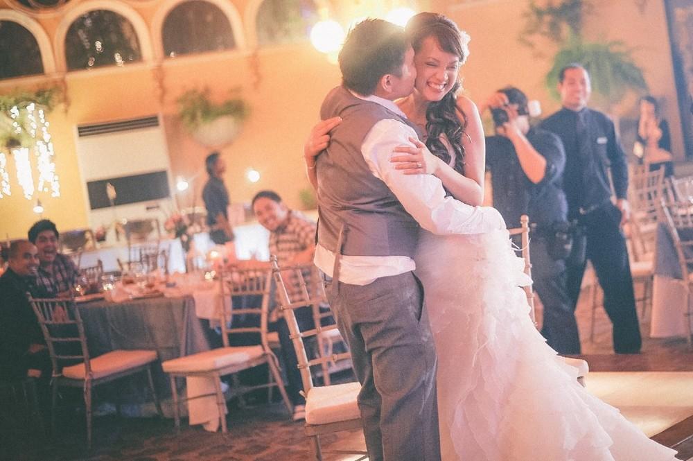 san   diego wedding photographer | groom kissing bride on cheek on dance floor