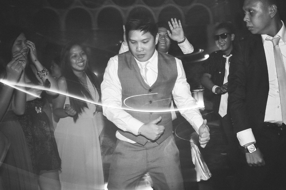 san   diego wedding photographer | monotone shot of groom dancing in middle of   crowd